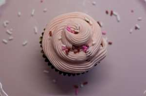 Strawberry buttercream over vanilla cupcake
